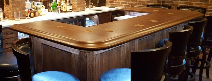 http://www.hardwoodsincorporated.com/wp-content/uploads/2014/02/home-bar-with-underlighting-slide.jpg