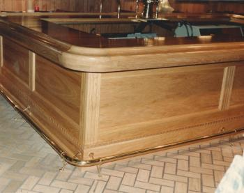 Commercial bar made with our newest Chicago Bar rail design BR 475S featuring custom radius corners in red oak