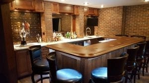 Custom Home Bar trimmed with our BR475 Bar rail Molding & Radius Bar Rail Corners.