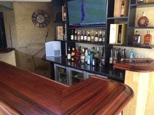 Completed home bar using our curved bar rail corners.