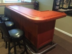 Completed home bar trimmed with our original Chicago Bar Rail Molding BR475-S