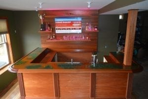 Completed bar using our bar front parts, bar rail & moldings in Mahogany.