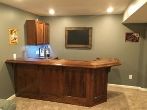 Beautiful solid walnut home bar and Traditional wood bar arm rest molding.