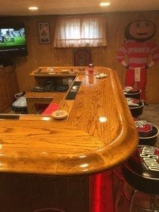 Custom bar by our client Rick in Ohio featuring our curved wood arm rest molding.