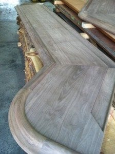 Custom walnut bar top with our curved Chicago Style bar rail molding.