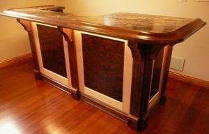 Custom Home bar with our BR475 Bar arm rest molding and radius corners.