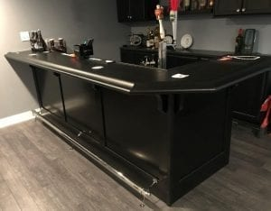 Gorgeous dark wood home bar.