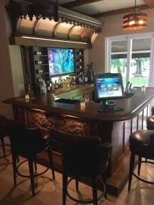Custom home bar, back bar and canopy.