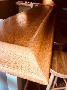 The original wood bar arm rest molding.