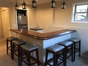 Custom home bar top with American Walnut Chicago bar rail molding.