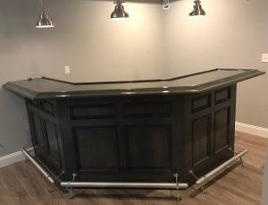 Custom maple home bar with Chicago style bar rail.