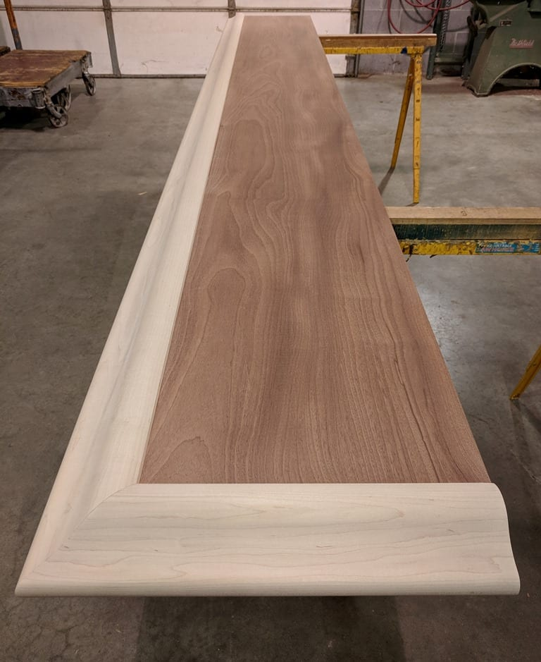solid Sapele mahogany slab trimmed with our maple BR475 Bar rail molding1