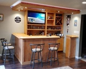 Solid maple home bar with Chicago bar rail molding.