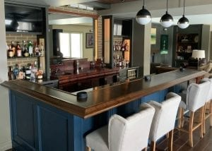 Another DIY custom home bar featuring Our BR475 Chicago bar rail m olding.
